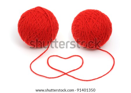 Two thread balls with heart isolated on white background.