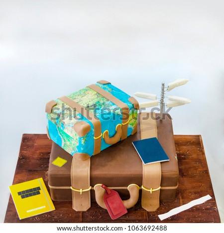 Two tier suitcase shaped cake celebration stock photo download now two tier suitcase shaped cake celebration cake for bon voyage and travel gumiabroncs Gallery
