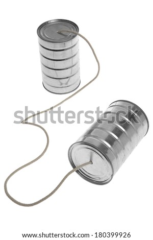 Two tin cans with rope to communicate on white  - stock photo