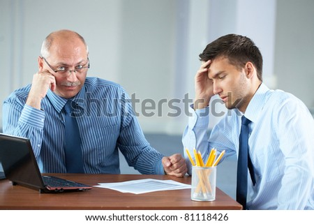 two tired, sad and overworked businessman get a break, and some rest, office shoot - stock photo