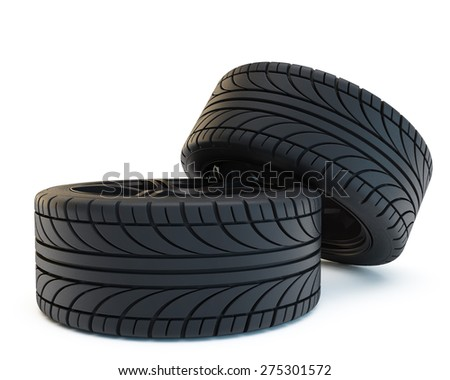 two tires on black disks lie one on another - stock photo