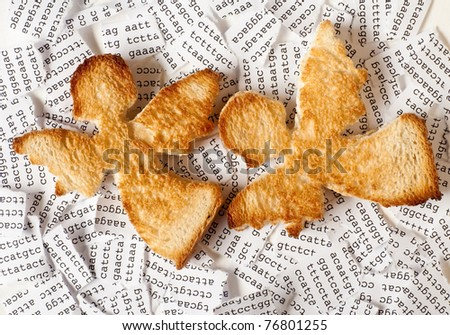 Two toasts in a form of angel with a background of a tore DNA sequence - stock photo