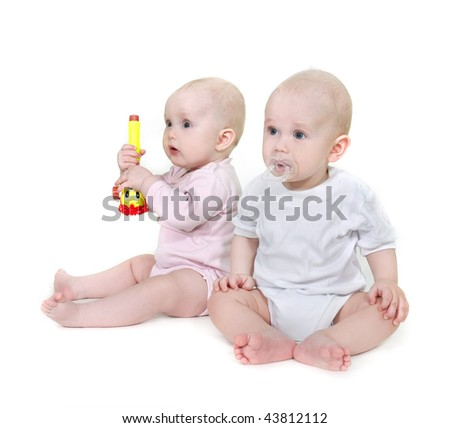 two toddlers over white - stock photo