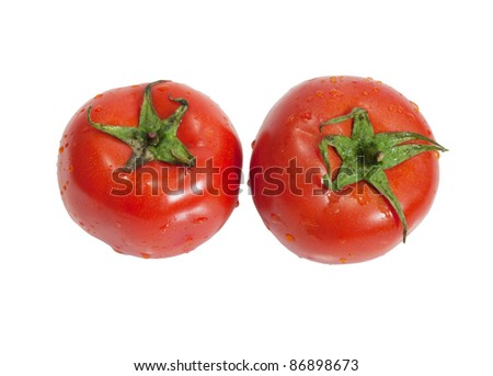 two tomatoes on a white background - stock photo