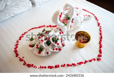 two towel swans shaped on the bed,Honey moon bed - stock photo