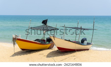 two traditional boats at the beach - stock photo