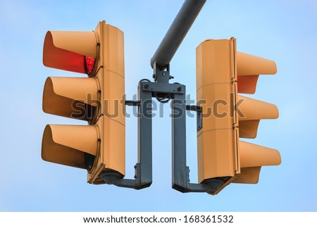 two traffic lights on sky background - stock photo