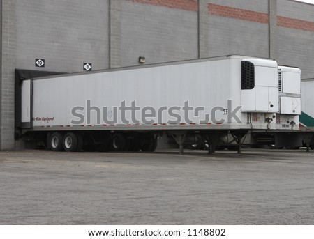 Two Trailers at Truck Loading Dock at Warehouse or Shipping Facility - stock photo