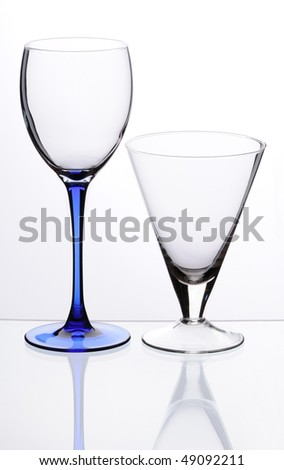Two transparent empty glasses stand on a table