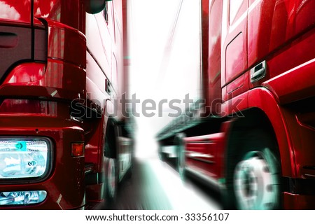 two trucks on the road - stock photo