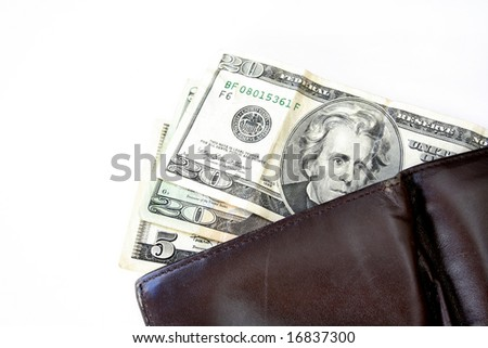 Two twenties and a 5 hanging out of a wallet isolated on a white background. - stock photo