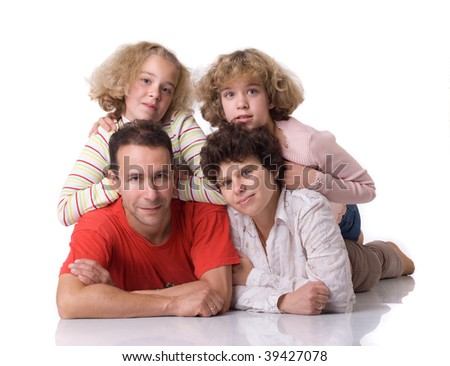 Two twins (girls)   with parents on white background