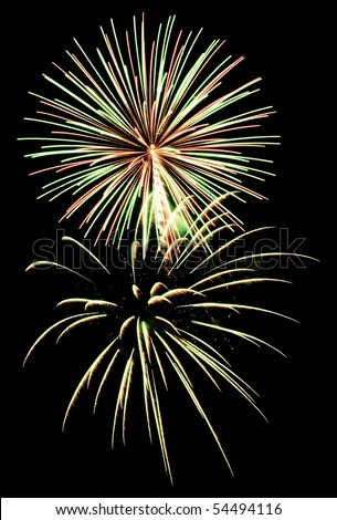 Two types of fireworks, one burst with many more streaks than the other - stock photo