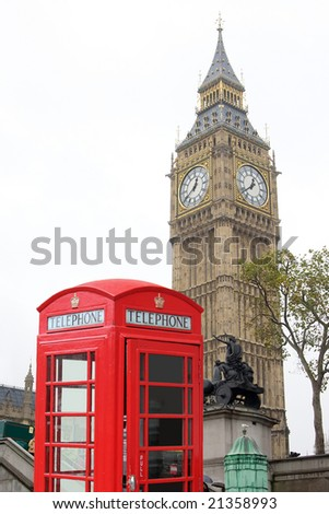 Two typical icon of London, UK, the Big Ben, and a red telephone booth; this is a combination of two separate images - stock photo