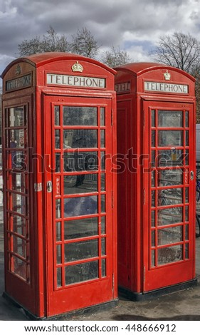 Two typical red english telephone booths  - stock photo