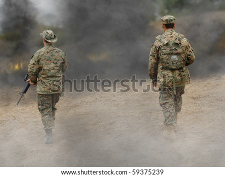 Two US Marines on the battlefield - stock photo