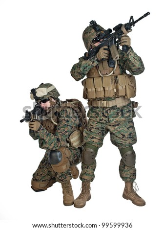 Two US marines with rifles in action - stock photo