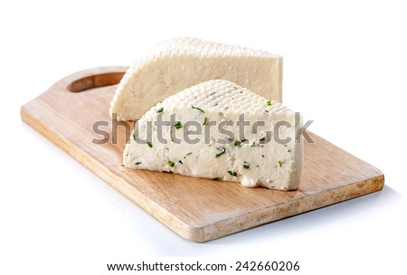 two varieties of soft cheese slabs on wooden cutting board isolated over white background  - stock photo