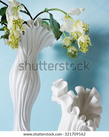 two vases close up and the one with flowers - stock photo