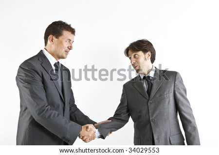 two  victorious businessmen shacking hands - stock photo