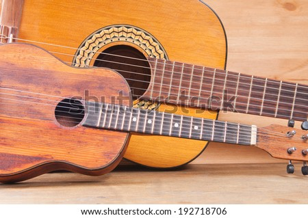 Two vintage acoustic guitars, child and adult - stock photo