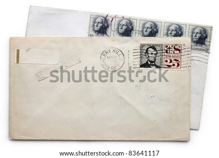 Two vintage airmail envelopes with Abraham Lincoln and George Washington postage stamps from USA. - stock photo