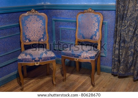 two vintage chair on wooden floor - stock photo
