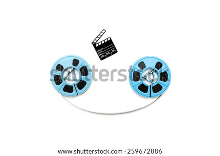 Two vintage 8mm blue reels horizontally connected with film and a little clapper board isolated on white background - stock photo