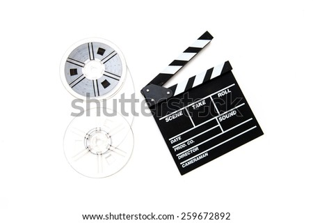 Two vintage 8mm reels connected with film and clapper board isolated on white background - stock photo