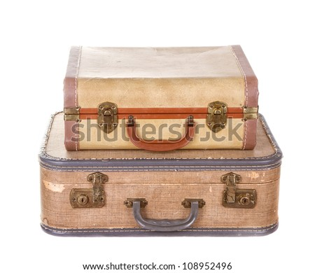 two vintage suitcases stacked isolated on white - stock photo