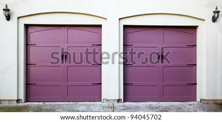 Two violet, purple, amethyst, or lavendar garage doors - stock photo