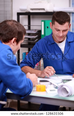 Two warehouse managers checking stock - stock photo
