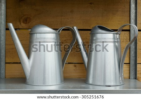 Two watering cans - stock photo