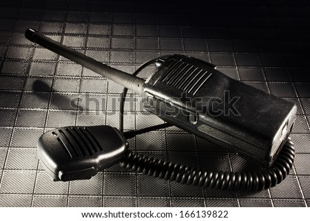 Two way radio in the dark along with its microphone - stock photo