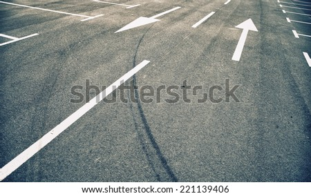 Two-way street arrow signs and parking lots. - stock photo