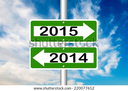 Two Way Street Road Sign Pointing to 2014 and 2015 with a blue sky in a background - stock photo