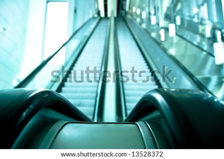 Two ways escalator in blue tone. - stock photo
