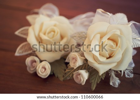 Two wedding boutonnieres of roses lie on the board - stock photo