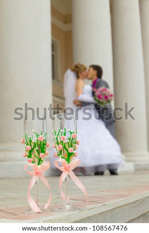 two wedding goblet filled with champagne - stock photo