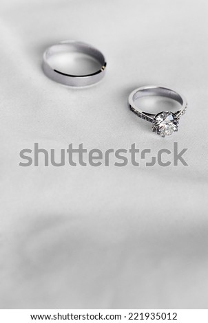 Two wedding ring on fabric background