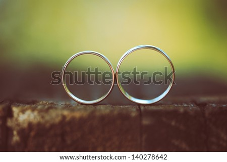 Two wedding rings in infinity sign. Love concept. - stock photo