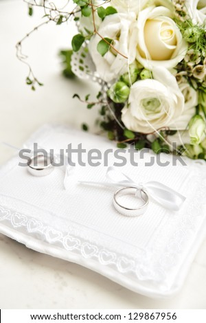 Two wedding rings on a white pad