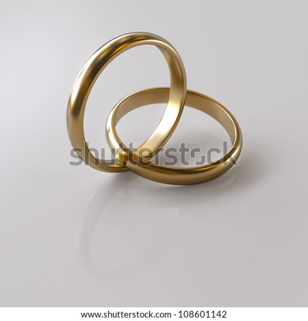 Two Wedding rings on grey background whit clipping path