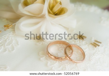 Two wedding rings on the pillow - stock photo