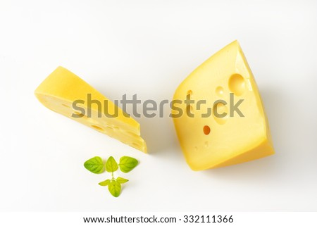 two wedges of fresh cheese on white background - stock photo