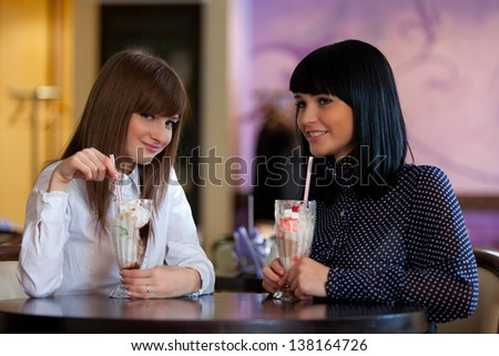 two wemen sit in cafe - stock photo