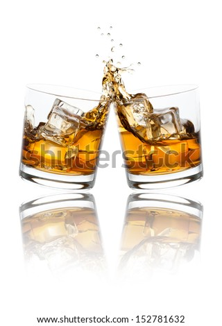 Two whiskey glasses clinking together, isolated on white. - stock photo