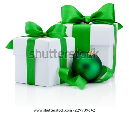 Two White boxs tied green satin ribbon bow and christmas ball Isolated on white background - stock photo