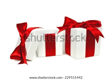 Two white Christmas gift boxes, one open, with red ribbon isolated on white