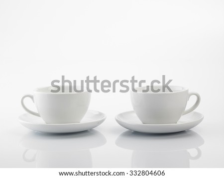 two white coffee cup on the white background - stock photo